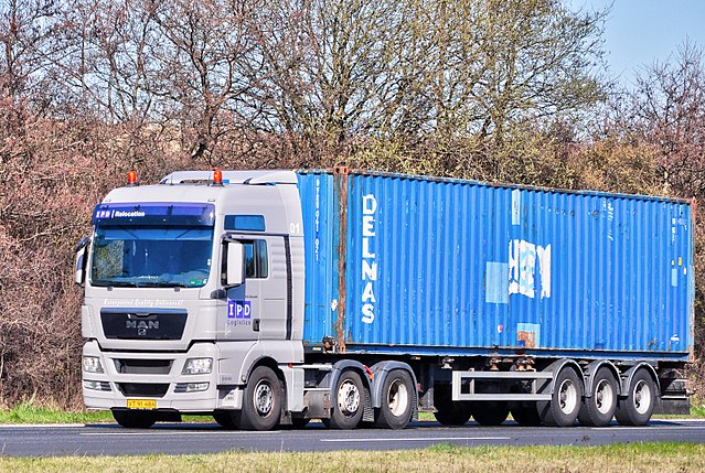 white lorry truck with blue trailer